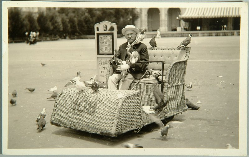 Henry Heyman sitting in cart with pigeons