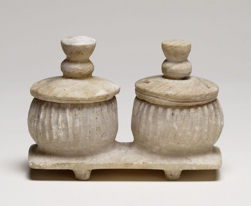 Lidded containers on a stand