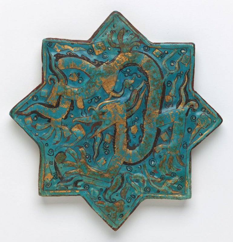 Star tile with raised dragon decoration