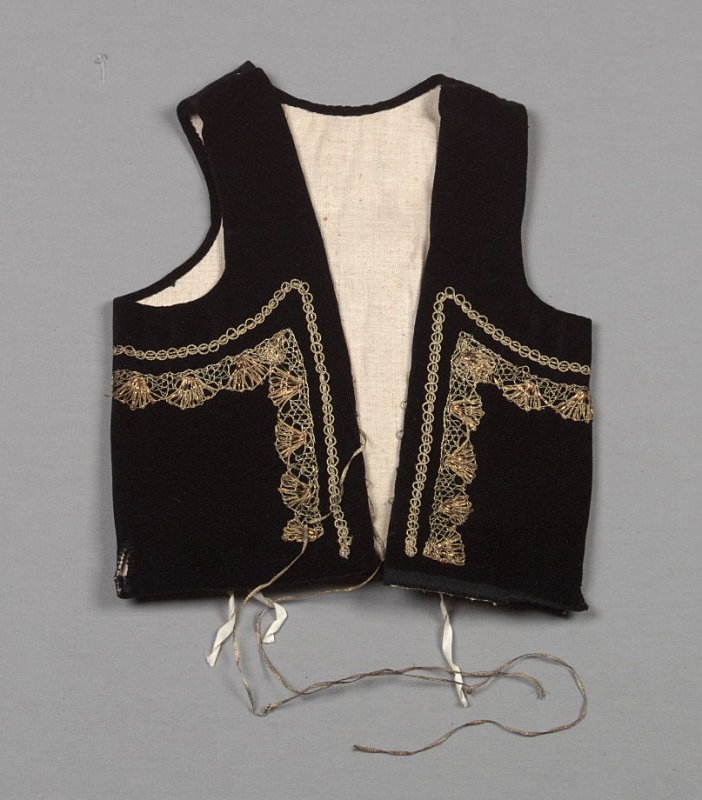 Vest from girl's ensemble: blouse, skirt and vest (with d: under-dress and e: collar