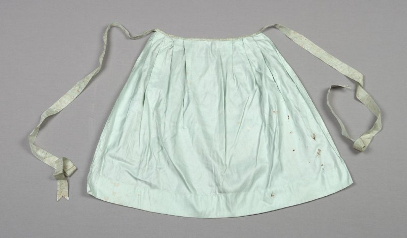 Apron from child's Swiss costume; blouse, apron, skirt, bonnet, ribbon, leggings, twonecklaces and pin