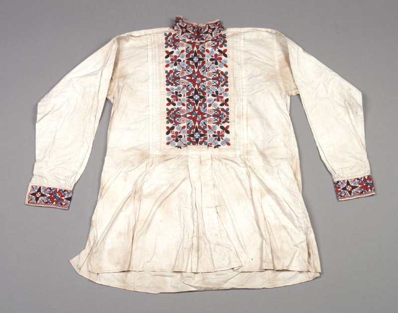 Shirt: white cotton with red and blue embroidery