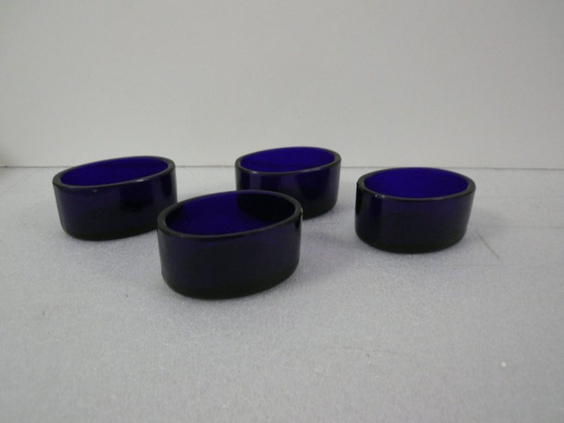 Four blue glass liners for salts found w/paper reading: 4 blue Peking glass dishes Fagin coll. (1944.10?)