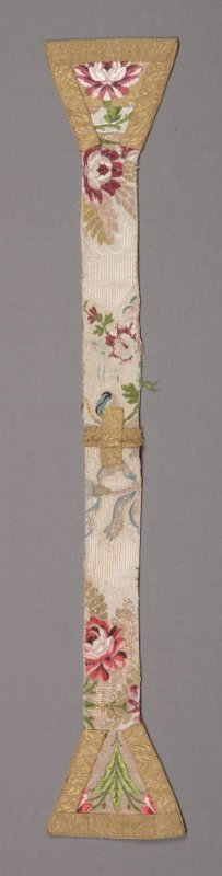 Stole polychrome flowers and ribbons on white, gold cross at neck,