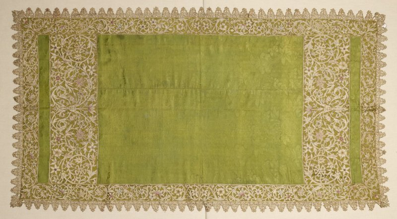 Green brocade panel with appliqued lace