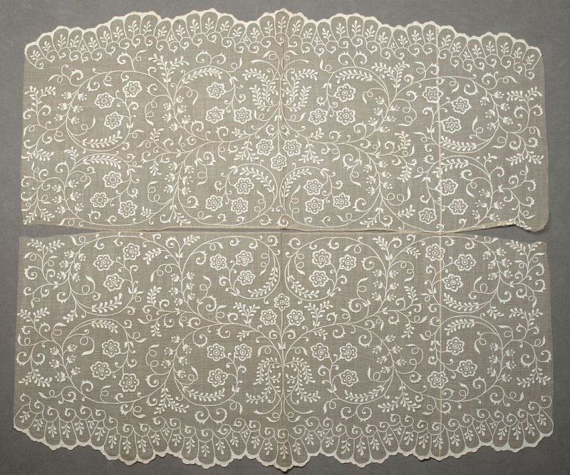 Two panels: net with applique in floral pattern, one scalloped edgewith bodice X1989.90