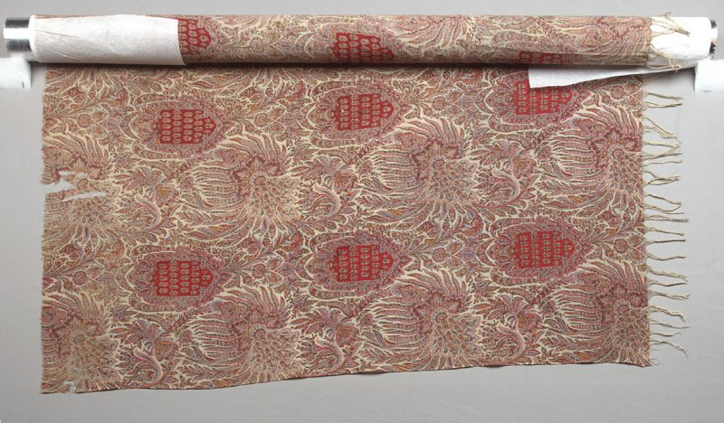 Shawl repeating red shield with paisley pattern