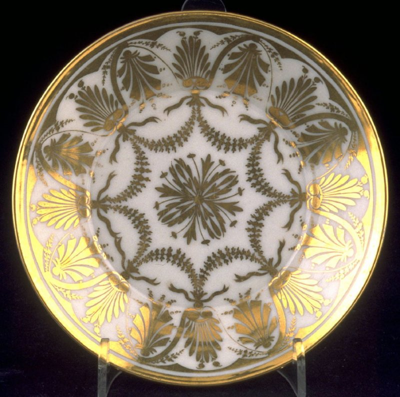 White saucer with gold decorations