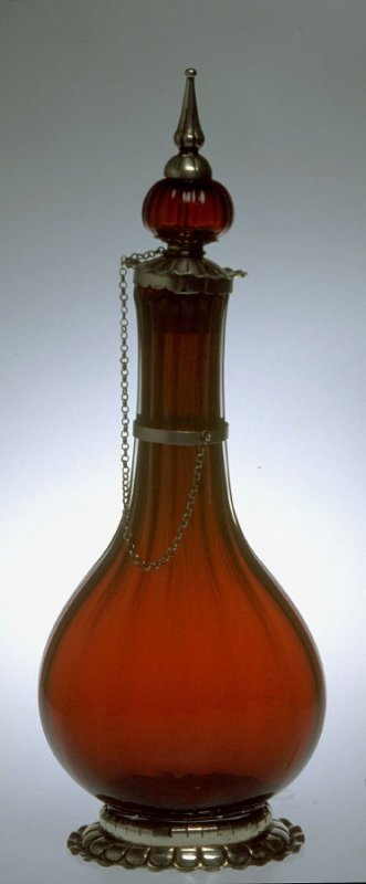Bottle with scalloped neck and stopper on chain