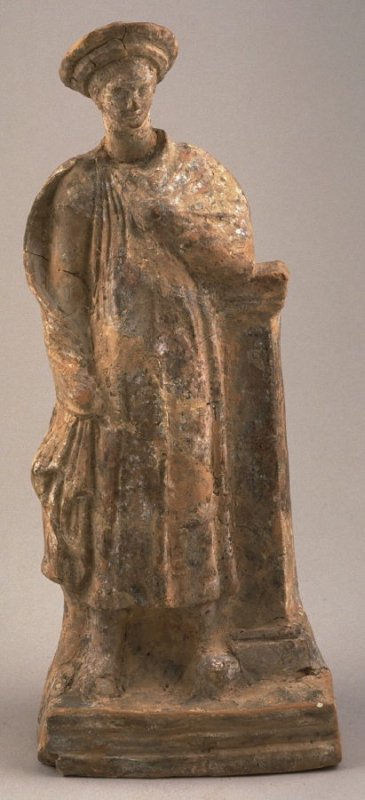 Standing draped male figure leaning against a pedestal