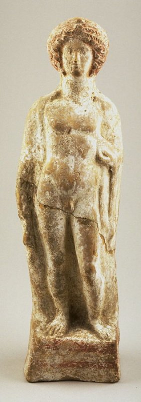 Standing male nude figure with an elaborate coiffure