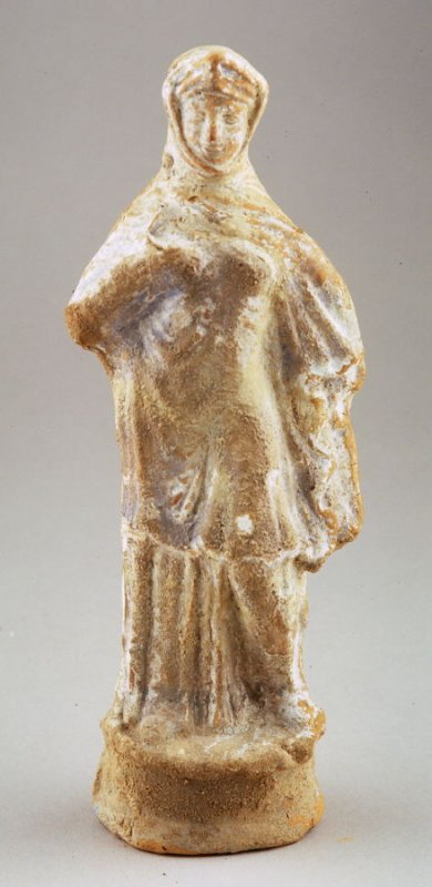 Standing draped female with cap