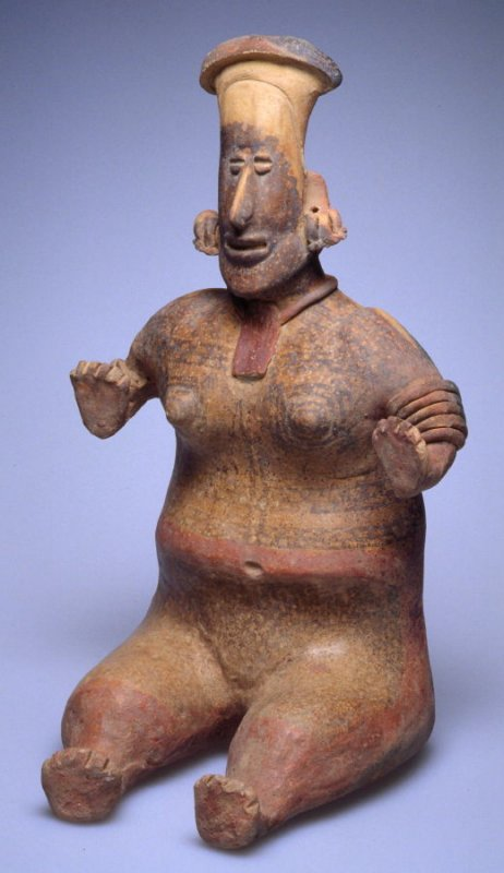 Seated female figure with body paint