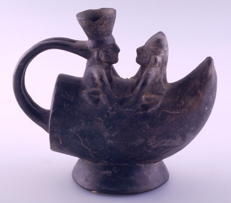 Water jar in form of boat with two male figures