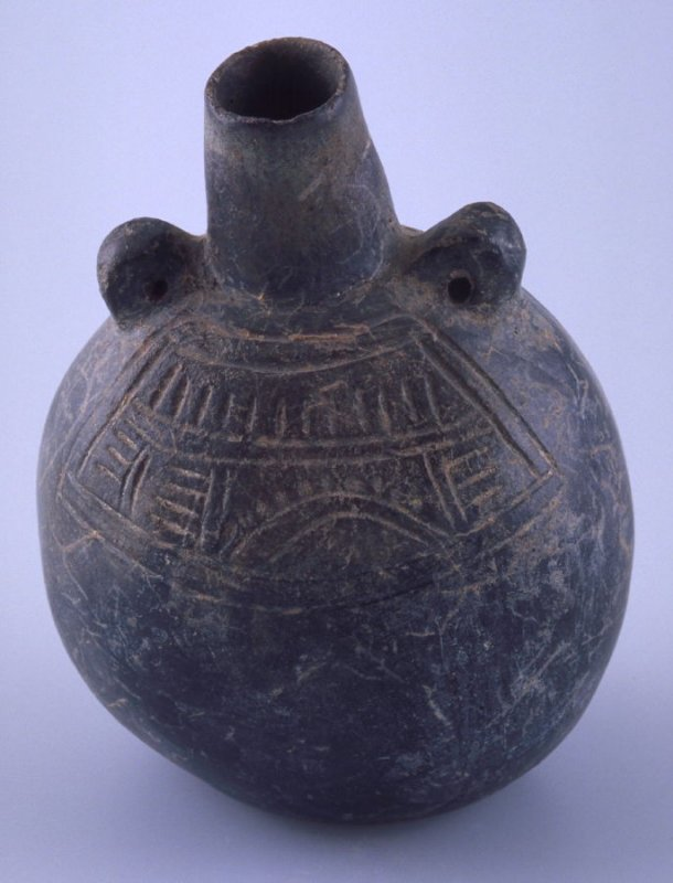 Jar with tall neck and geometric designs