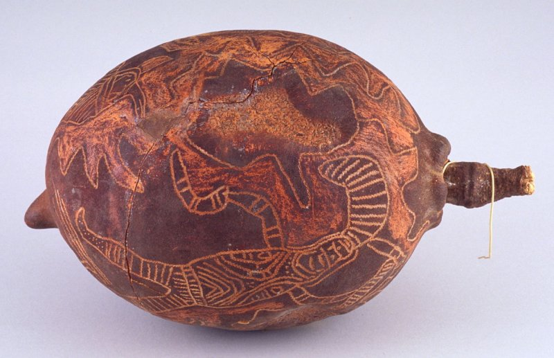 Baobab nut with man and turtle design