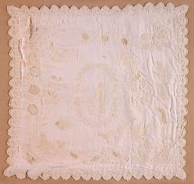 Sampler: whitework with floral design with scalloped edges