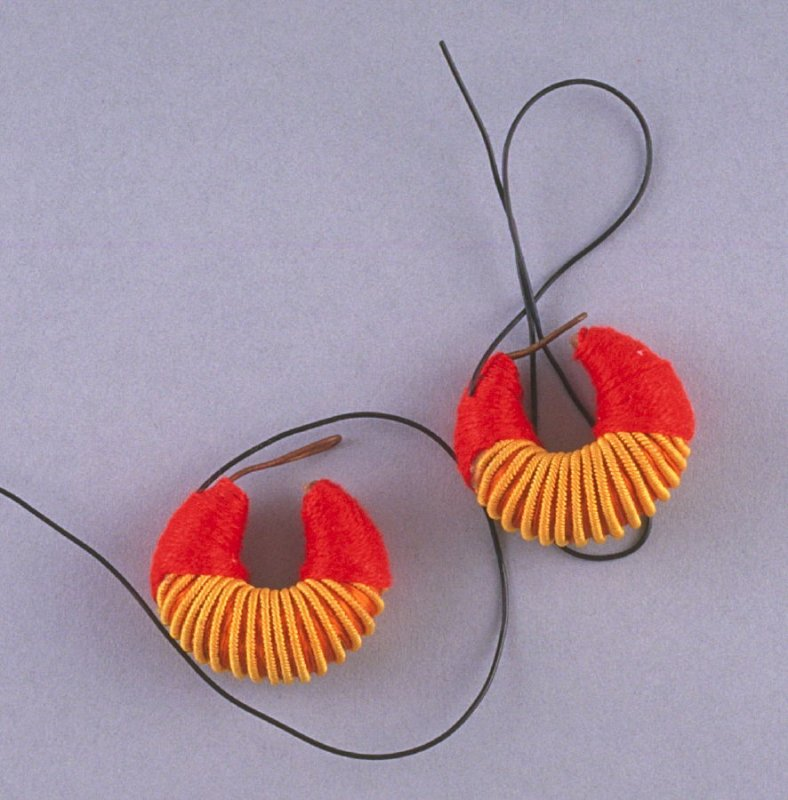 Earrings with red cord
