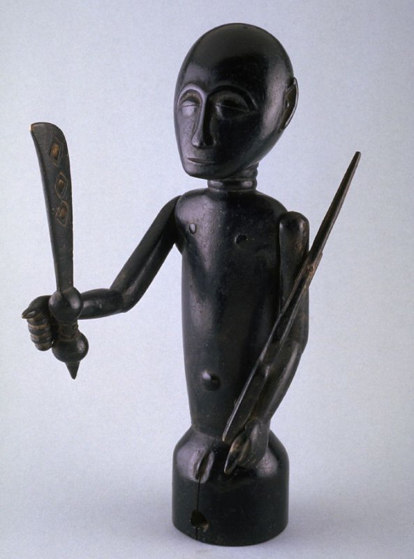 Figure with rifle and machete (umbrella top)