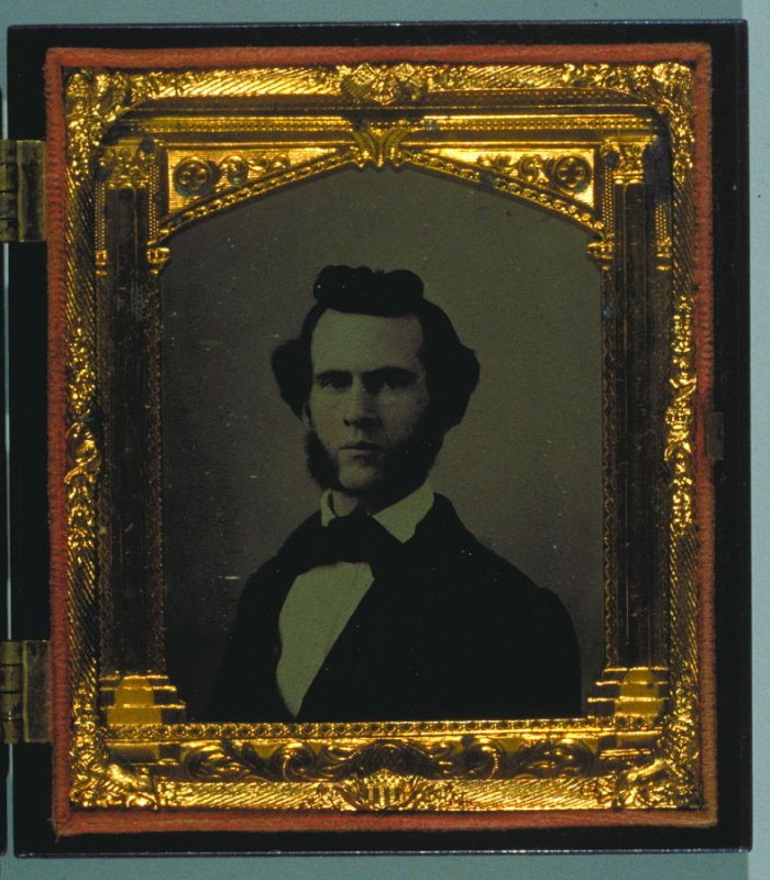 1/6 plate Portrait of a young man with hand coloring in a fountain Union case by S. Peck & Co.