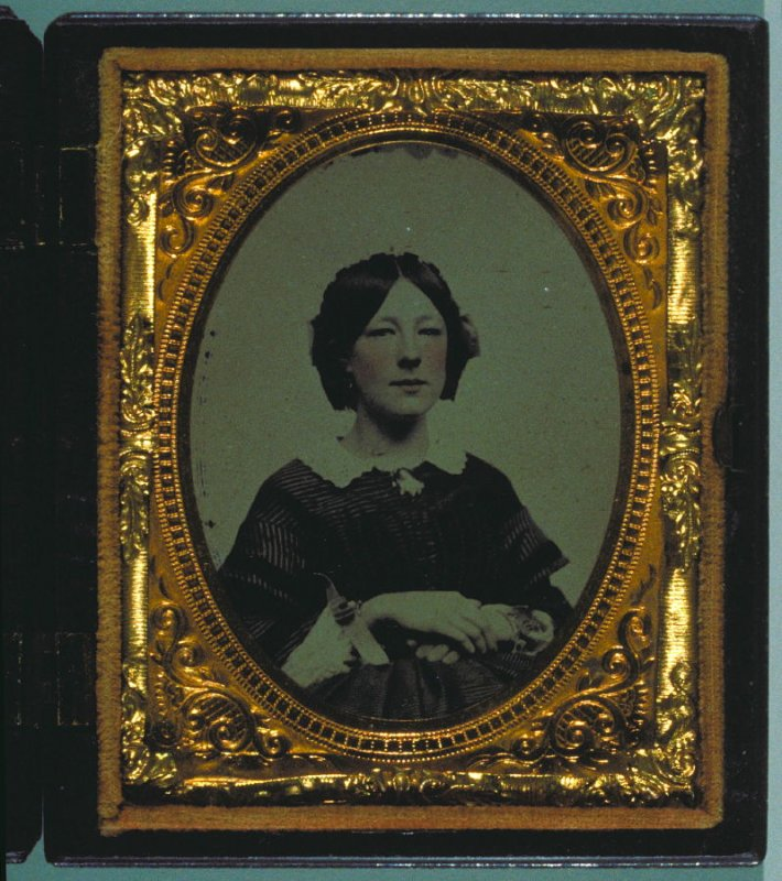 Portrait of a woman with hand coloring in a Union case by Littlefield, Parsons & Co. with angel with trumpet on front, children with butterfly net on back