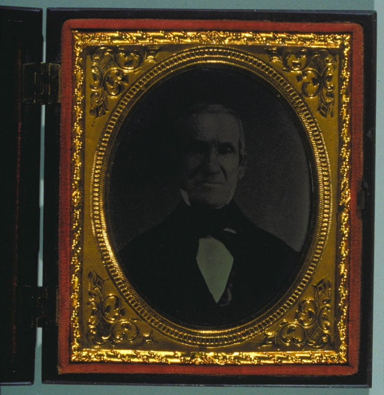 Portrait of an older man with hand coloring in Union case by Littlefield, Parsons & Co. with behive motif