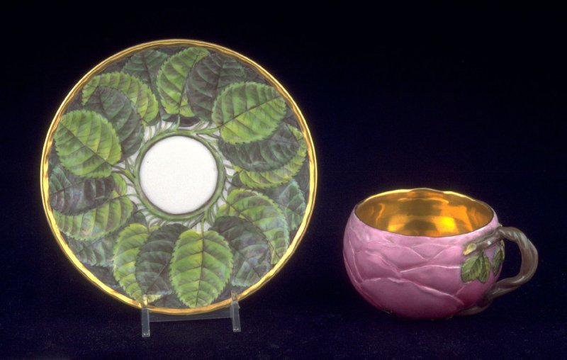 Cup and saucer with leaf design