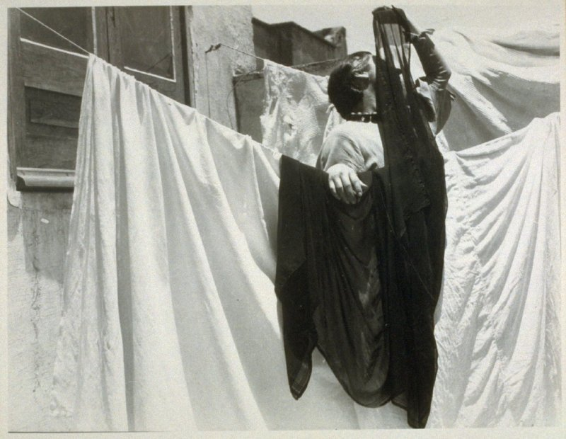 Untitled (woman hanging wash), from a series of photographs of washerwomen