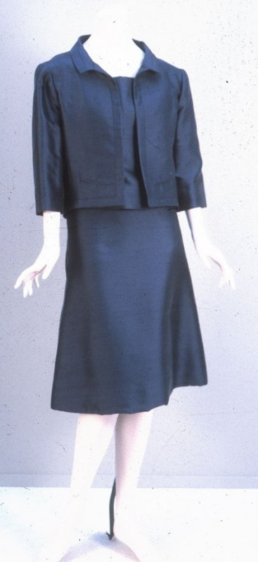 Suit: jacket, skirt, and top