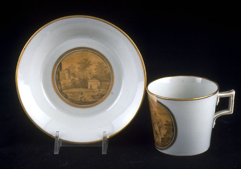 Cup and saucer with castle scene