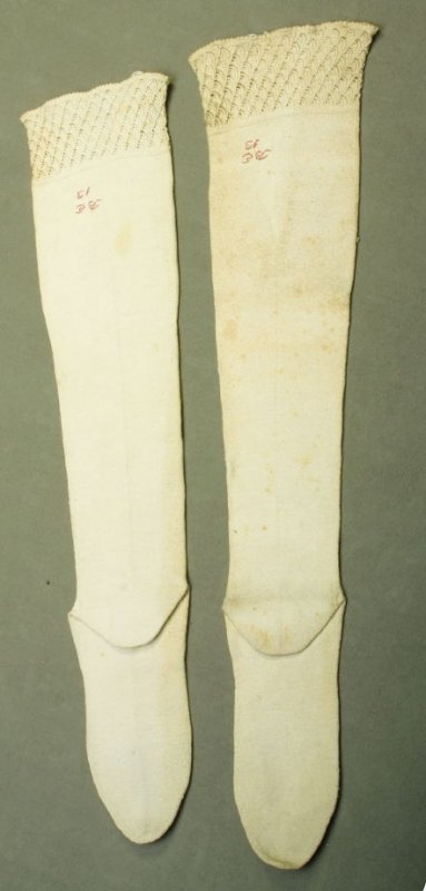 "Pair of stockings: inscribed in red, ""B.E. 13"""