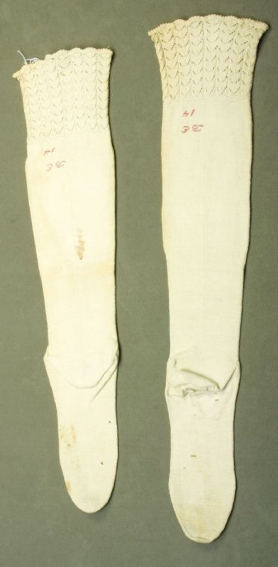 """Pair of stockings: inscribed in red, """"B.E. 14"""""""