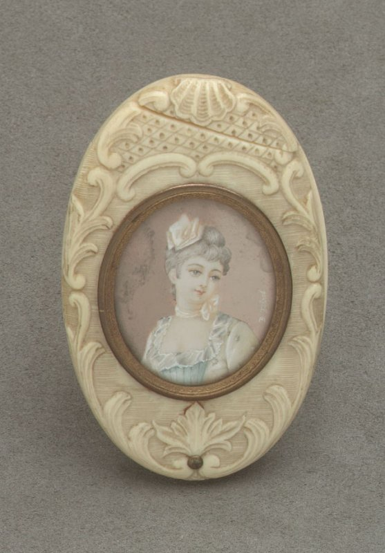 Pocket mirror with miniature of woman on cover