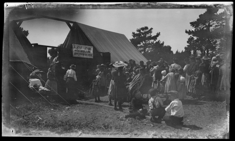 Untitled (Negative not scanned. Women and children on line outside sewing tent)