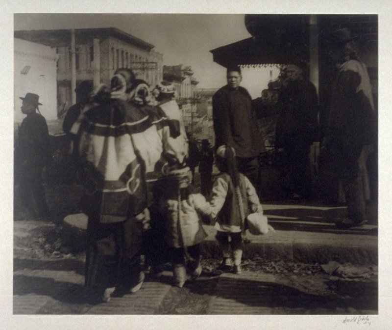 Untitled (Group of elegantly dressed women and children seen from behind as they approach a street corner) from the Chinatown Series