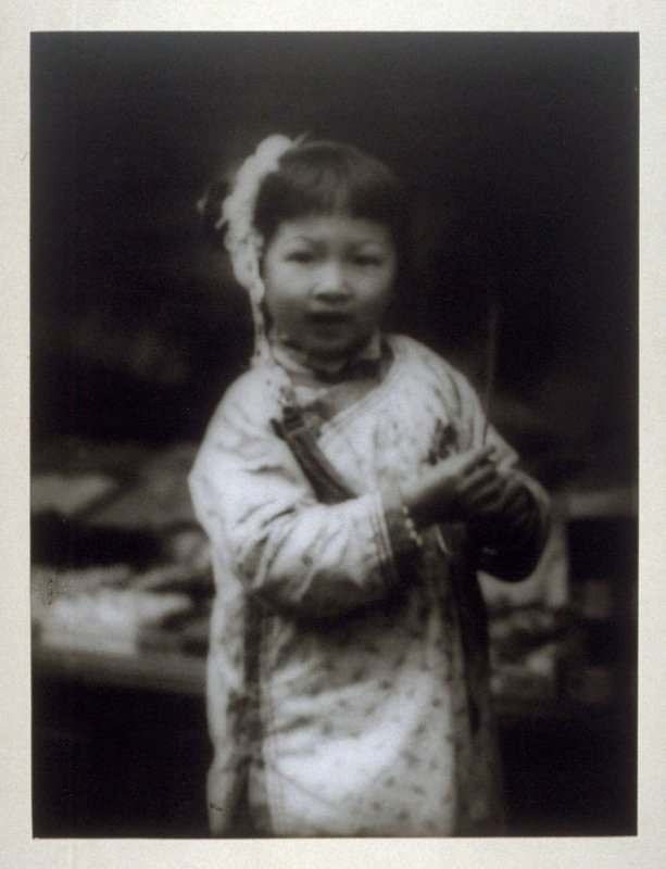 Untitled (Young girl holds a strand of wheat) from the Chinatown Series