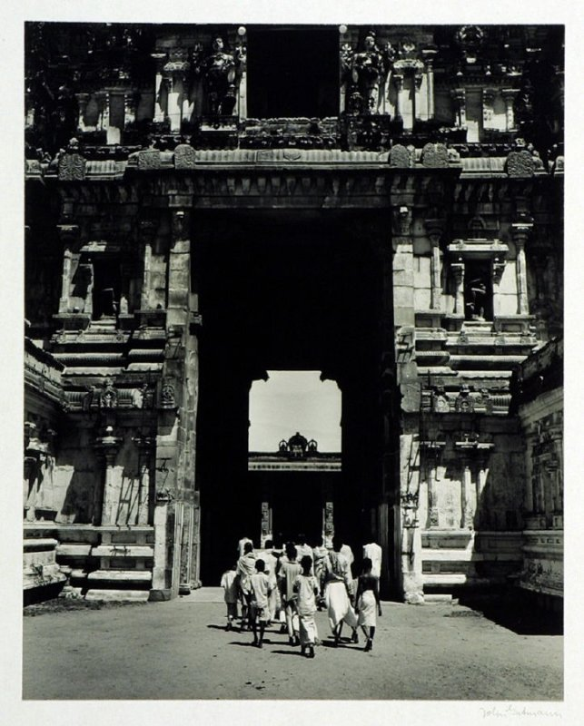 A group of worshippers entering the tower gateway of the Great Shiva Temple at Conjeeveram, South India.