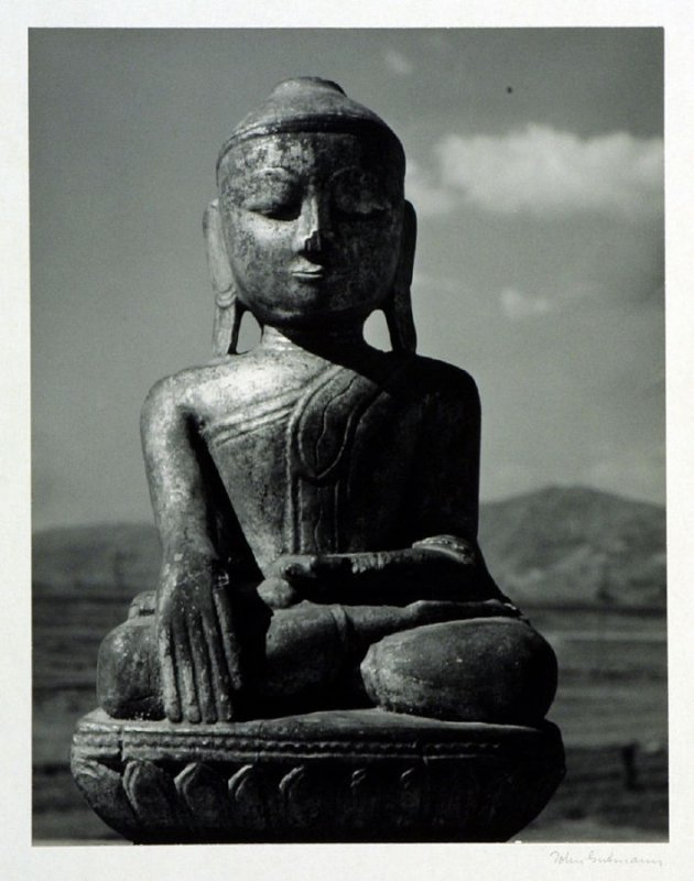A Burmese Buddha statue in guilded wood.