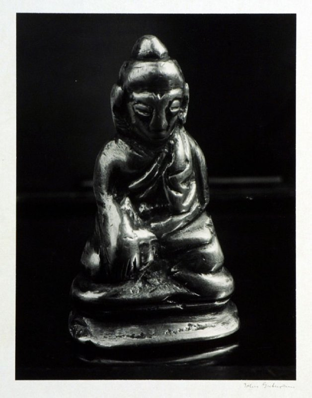 """Meditating Buddha, probably Tibetan, brass and gold two """" high. The image is well worn off by rubbing it in hand as charm for good luck."""