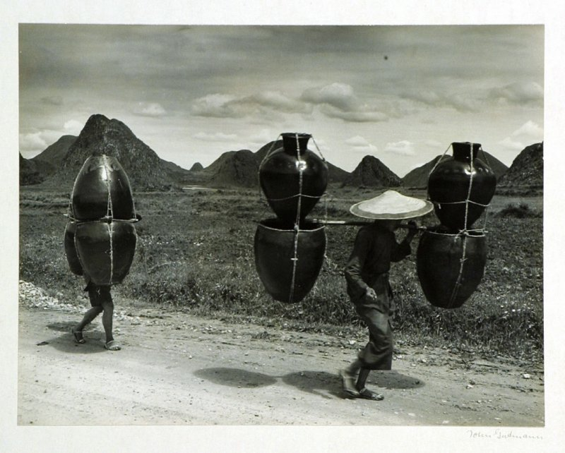 Kweichow potters carrying their earthenware to the market. By far the most important means used in Chinese transportation is the carrying pole. With a well balanced load of from 100 to 150 lbs. a Chinese might be on the road from 12-14 hours.