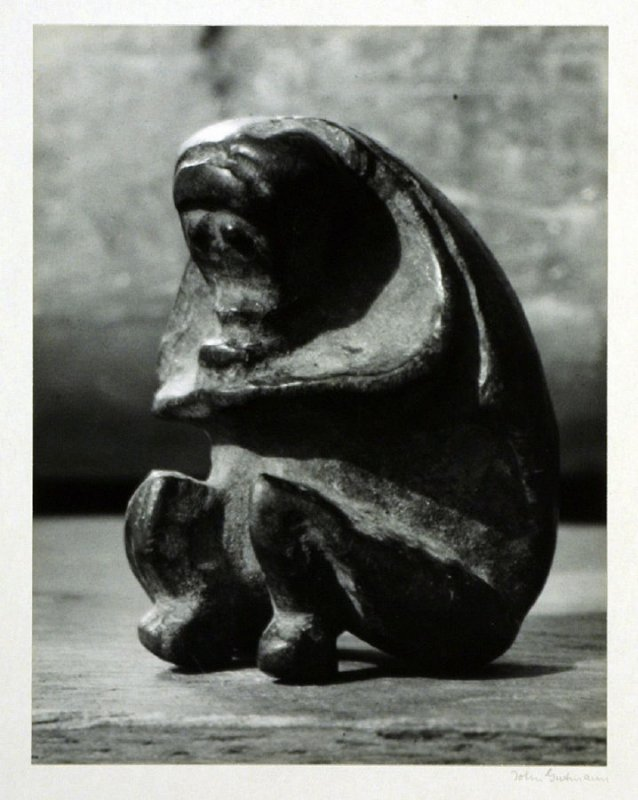 """Seated monkey, carved from a peach stone, one"""" high, Yunnan?"""