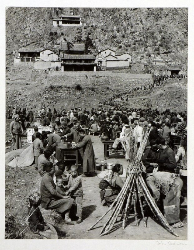 Peasant-pilgrims and town-people prepare hot lunches at small open kitchens before they climb up the final stretch to the Buddhist Temple of the Blue Mountain, near Kunming.