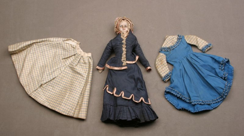 Doll with dark blue dress and bonnet (with extra 2 pc. dress: blue and white)
