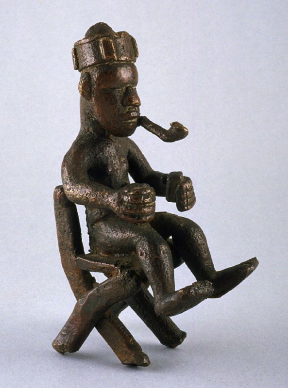 Seated man with pipe and matches