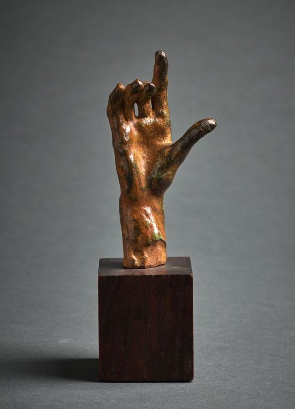 Hand with index finger extended