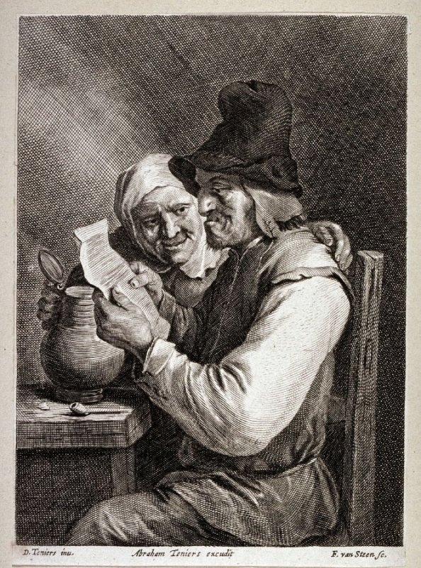 Man and woman seated, man reading letter
