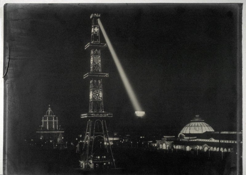 Electric Tower at Night Showing Administration Building and Horticulture Building, with Searchlight on Strawberry Hill