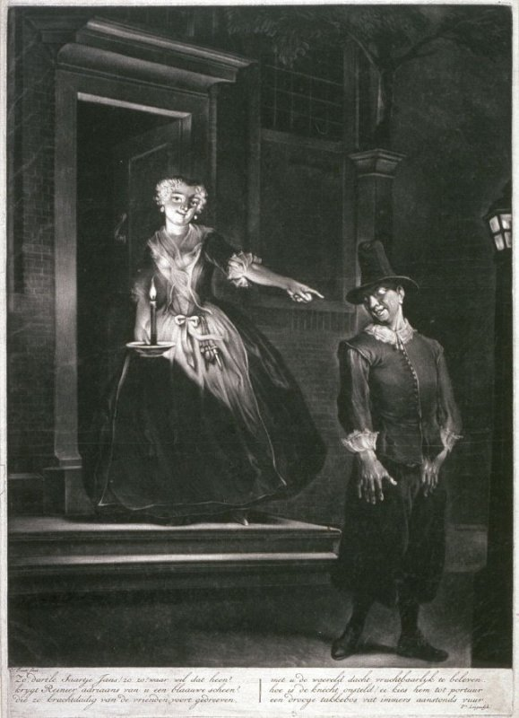 Young woman with candle in front of door pointing towards a young man