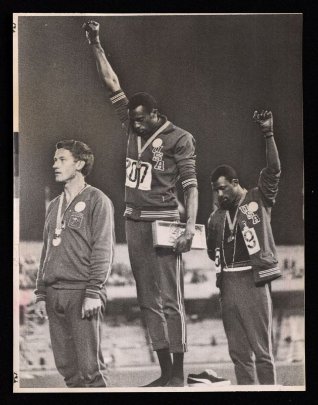 Americans Tommy Smith and John Carlos Raise Gloved Fists At Olympics