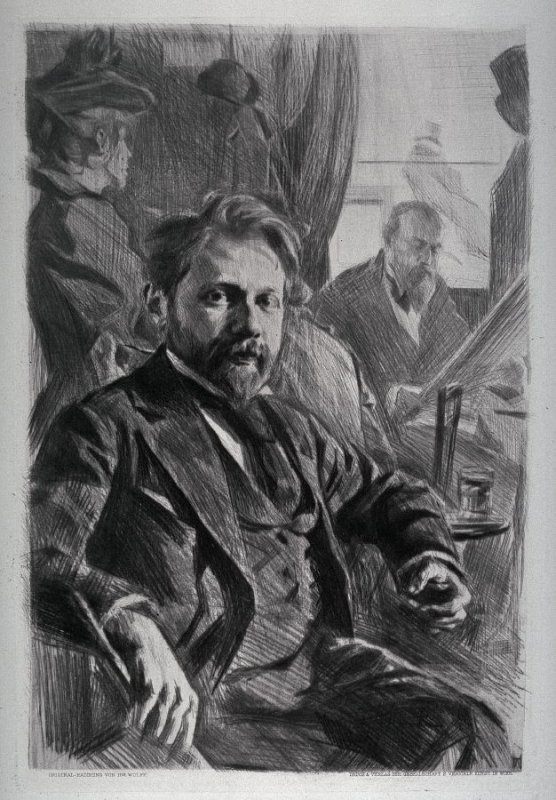 Portrait of one man sitting in foreground another man and woman in background